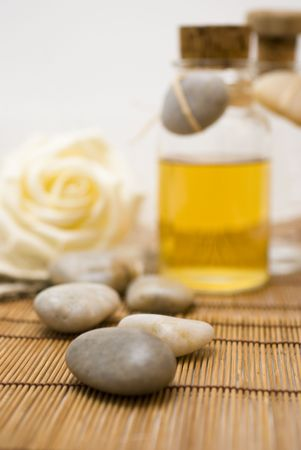 Zen stones - Accessories for wellness, spa or relaxing bath and Bottle with aromatic oil-accessory of weakening and improving procedures of aromatherapy