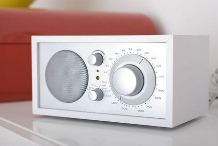 A modern radio set with retro design, white and silver metal Stock Photo