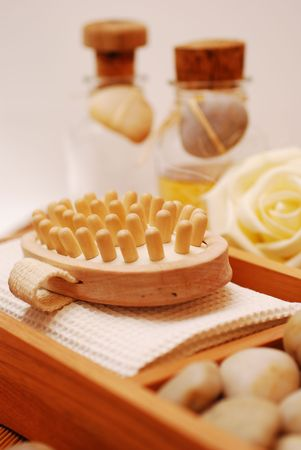 weakening: spa or relaxing bath and Bottle with aromatic oil-accessory of weakening and improving procedures of aromatherapy - Zen stones