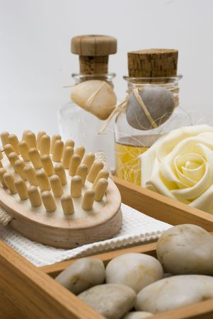 weakening: Accessories for wellness, spa or relaxing bath and Bottle with aromatic oil-accessory of weakening and improving procedures of aromatherapy - Zen stones Stock Photo