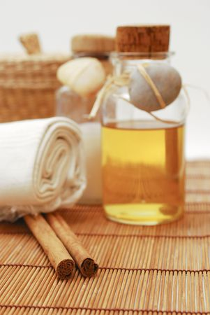 Bottle with aromatic oil or soap and towels - Accessories for wellness, spa or relaxing photo