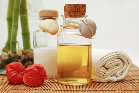 Bottle with aromatic oil or soap and towels - Accessories for wellness, spa or relaxing