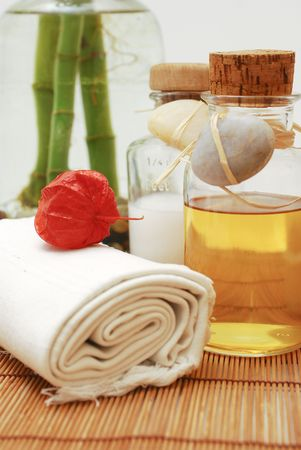 Bottle with aromatic oil or soap and towels - Accessories for wellness, spa or relaxing Stock Photo - 2576624