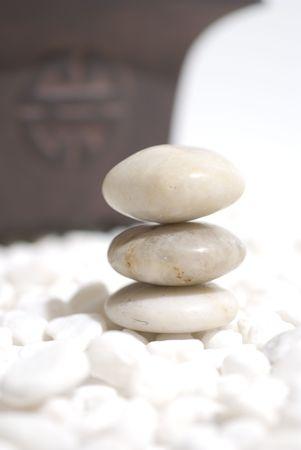 zen stones on white pebbles background - meditation concept photo
