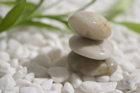 zen stones and bamboo on white pebbles background - meditation concept Stock Photo