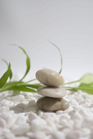zen stones and bamboo on white pebbles background - meditation concept Banco de Imagens