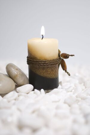 zen candles on white pebbles background - meditation concept Stock Photo