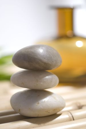 zen stones on bamboo background meditation concept photo