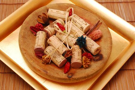 ferment: Various Corks and Golden plate decoration Stock Photo