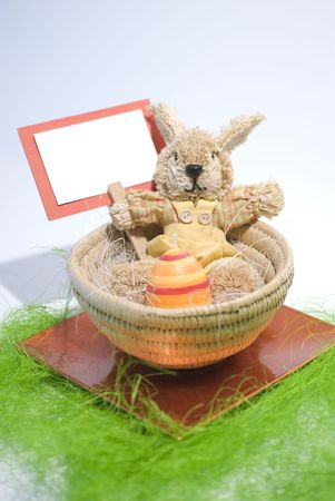Easter concept Colorful bunny in a basket photo