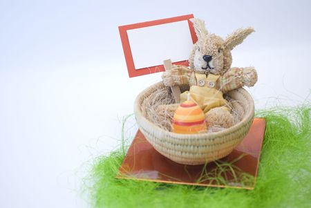 incubate: Easter concept Colorful bunny in a basket