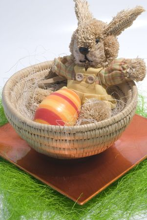 Easter concept Colorful bunny in a basket Stock Photo - 2639151