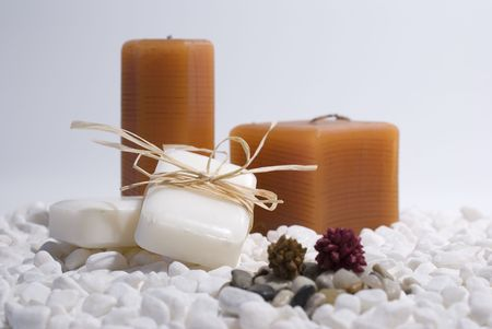 SPA zen candles and soap on white pebbles background,  meditation concept Stock Photo - 2715873