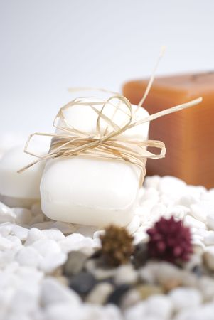 SPA zen candles and soap on white pebbles background,  meditation concept Stock Photo - 2715788