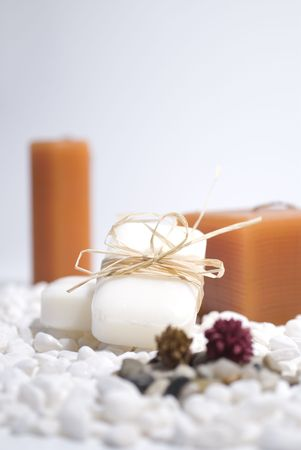 SPA zen candles and soap on white pebbles background,  meditation concept photo