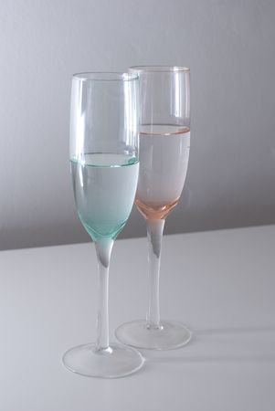 A crystal glass isolated, with light, water into the glass photo