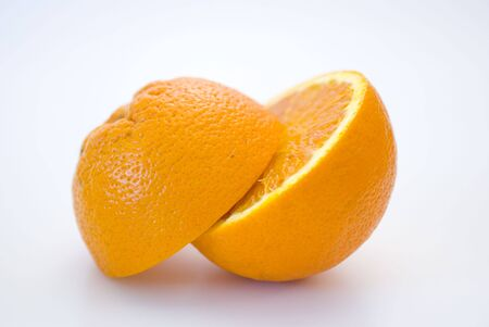 Fresh fruit, a tropical orange macro closeup, isolated on white photo