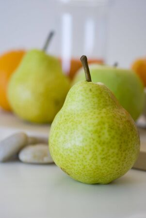 Pear and other fruits, close-up, fruit white background. Breakfast concept Stock Photo