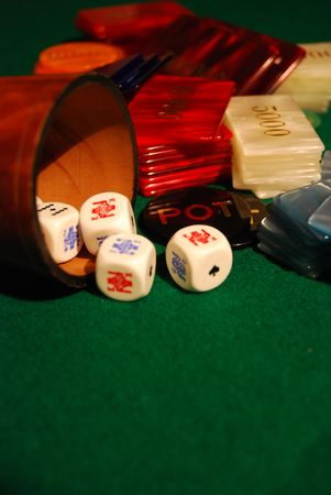 Poker chips arranged on green felt photo