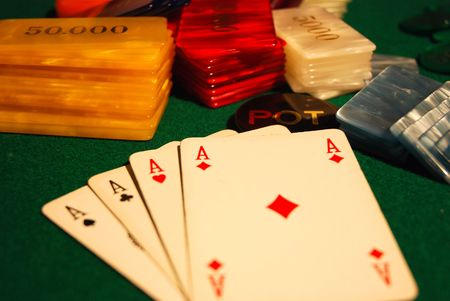 Cards and poker chips arranged on green felt Stock Photo - 2862671