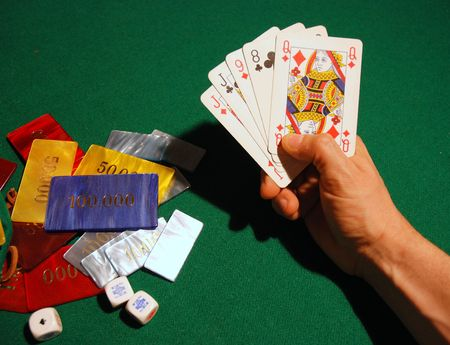 Cards and poker chips arranged on green felt