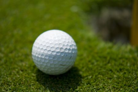 par: Golf club view of Golf ball in the putting green - sport
