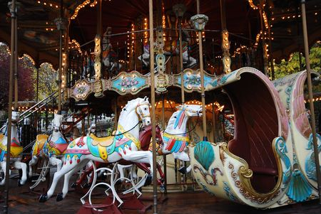Old Carousel horses at the amusement park going around in circles in Paris, France Stock Photo