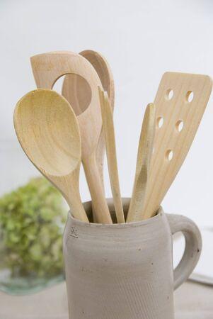 wooden kitchen utensils in a jug Stock Photo