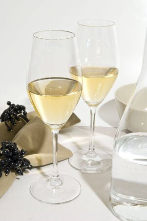 close-up over Glasses of white wine, bottle  and towels decoration