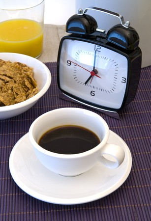 Close-up of a table and wonderful cup of hot coffee, alarm clock Stock Photo - 3955987