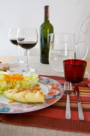 table with a glass of red wine and italian food Stock Photo - 3956006