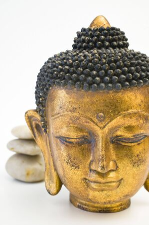Face of gold Buddha isolated on wight