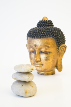 Face of gold Buddha isolated on wight photo