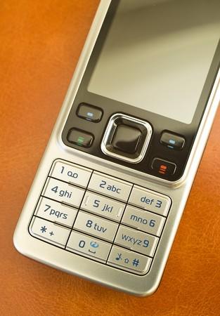 Mobile phone on skin orange agenda photo