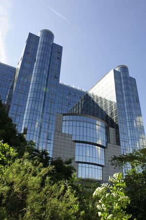 Facade of european parlament modern buildings in Brussels - Belgium Stock Photo