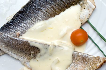 delicious prepared sea bass in white sauce with chive and cherry tomato Stock Photo - 1173682