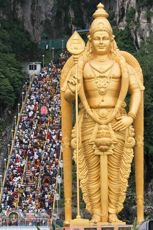lord Murugan big statue and thousand people climbing stairs during thaipusan festival, Kuala Lumpur, Malaysia
