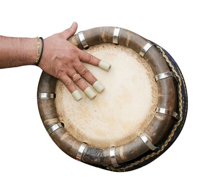 One hand playing Indian drum isolated on white photo
