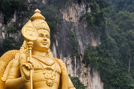 sacrifices: lord murugan statue at Batu caves, Malaysia
