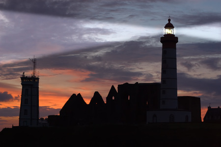 abbey: St Mathieu lighthouse and abbey ruins at dusk, Brittany, France