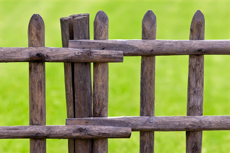 wooden fence protecting green field Stock Photo - 1481060