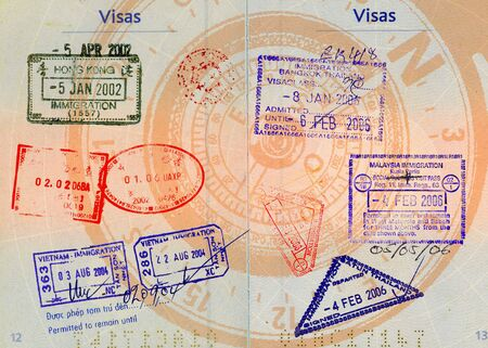 foreign land: hong kong,china,malaysia,thailand and vietnam stamps on french passport with compass in backgrounds high definition scan