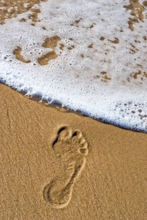 erased: right male footprint shortly erased by ocean