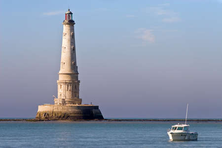 gironde: Cordouan Kings lighthouse and tourist boat, Gironde, France Stock Photo