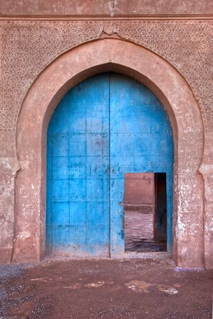 old ornated kasbah door entrance in morocco Stock Photo