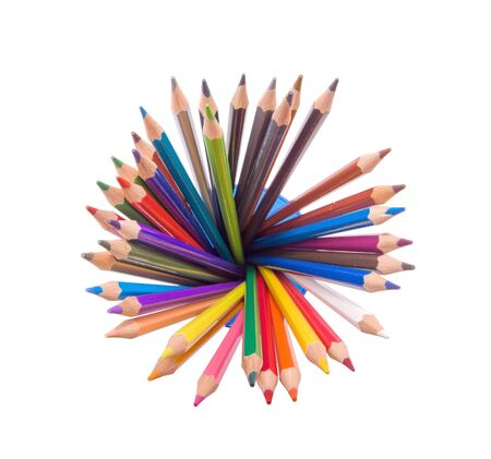 wide angle top view of assorted color pencils disposed in circle in a cup