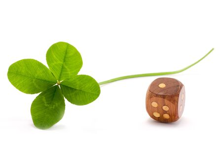 four leaves clover and wooden die on white background photo