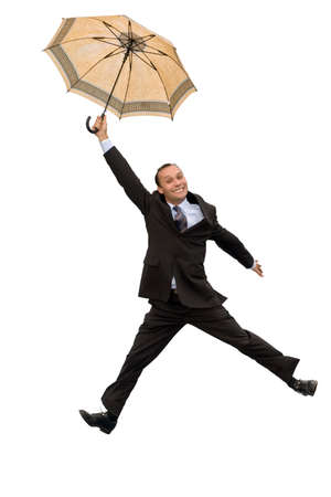 happy and free businessman flying with umbrella isolated on white photo