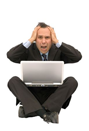 calamity: businessman with headache using computer