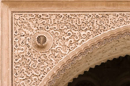 sculpted: arabic sculpted archway detail in morocco, ben youssef medersa, marrakesh